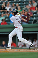 Shortstop Javier Guerra (31) of the Greenville Drive bats in a game against the Greensboro Grasshoppers on Thursday, August 27, 2015, at Fluor Field at the West End in Greenville, South Carolina. Guerra is the No. 13 prospect of the Boston Red Sox, according to Baseball America. Greenville won, 10-2. (Tom Priddy/Four Seam Images)