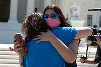 Pro-Life activists hug as they hold a 22 week fetal model during a rally outside the United States Supreme Court in Washington D.C., U.S., on Monday, June 29, 2020.  The Court delivered a 5-4 ruling blocking a restrictive abortion law in Louisiana Monday morning.  Credit: Stefani Reynolds / CNP /MediaPunch