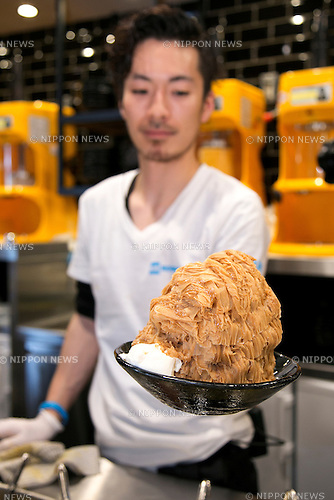"A member of staff shows a shaved ice dish during the pre-opening event of the new shaved ice restaurant ""Ice Monster"" in Omotesando shopping area of Shibuya district on April 27, 2015, Tokyo, Japan. Ice Monster is a Taiwanese store, which sells giant shaved ice desserts. It was selected as one of the ""Best Dessert 10"" by CNN and ""Best Desserts Around the World"" by Travel and Leisure Magazine. The store will open to the public on April 29th. (Photo by Rodrigo Reyes Marin/AFLO)"