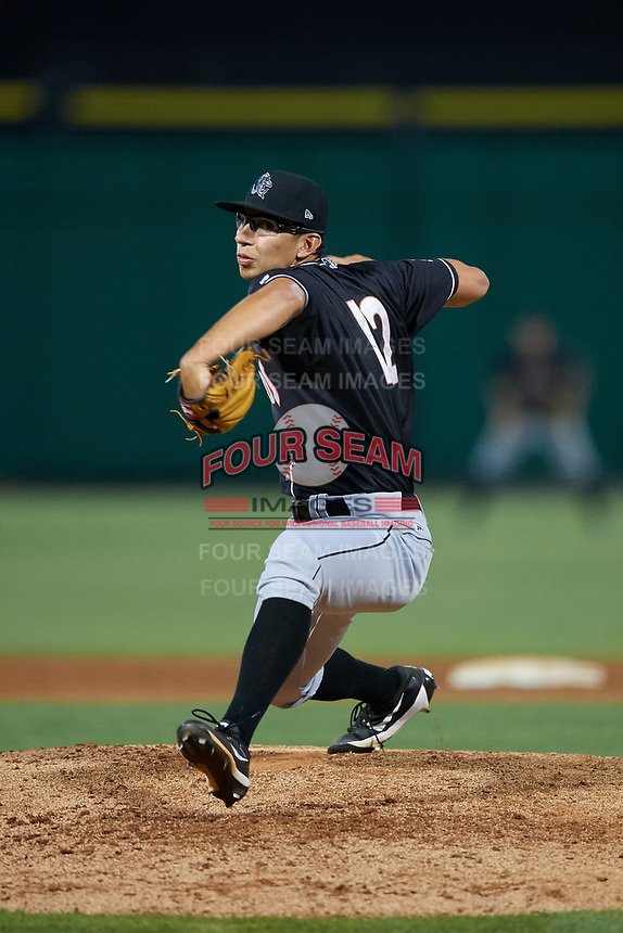 Jupiter Hammerheads starting pitcher Robert Dugger (12) delivers a pitch during a game against the Clearwater Threshers on April 12, 2018 at Spectrum Field in Clearwater, Florida.  Jupiter defeated Clearwater 8-4.  (Mike Janes/Four Seam Images)