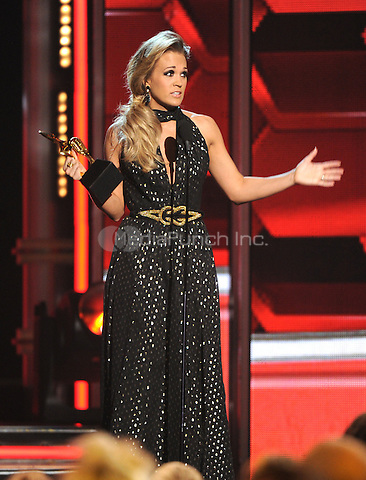 LAS VEGAS, NV - MAY 18: 5 Carrie Underwood accepts the Milestone Award at the 2014 Billboard Music Awards at the MGM Grand Garden Arena on Sunday, May 18, 2014 in Las Vegas, Nevada. PgMicelotta/MediaPunch
