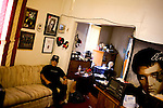 TIME, Arapahoe County Assignment..Small towns in far eastern Arapahoe County.  Byers, Deer Trail, Aurora, Watkins...Western towns, urban.  Littleton, Aurora....Elvis Gallego, an Elvis impersonator, McCain supporter, and postal worker, sits for a portrait in his home near downtown Littleton, Colorado.  Gallegos initially backed Clinton before switching to McCain fearing Barack Obama, the Democratic Presidential Nominee, lacked the requisite experience for the presidency..