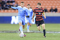 Houston, TX - Friday December 9, 2016: Zach Wright (10) of the North Carolina Tar Heels brings the ball up the field with Drew Skundrich (12) of the Stanford Cardinal chasing him at the NCAA Men's Soccer Semifinals at BBVA Compass Stadium in Houston Texas.