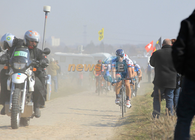 Riders including Martin Elmiger (SUI) IAM Cycling leads Ian Stannard (GBR) Sky Procycling through pave section 11 d'Auchy a Bersee during the 111th edition of the 2013 Paris-Roubaix cycle race, France 7th April2013 (Photo by Eoin Clarke 2013)
