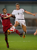 Carli Lloyd, Candace Chapman. The USWNT defeated Canada in extra time, 2-1, during the 2008 Beijing Olympics in Shanghai, China.