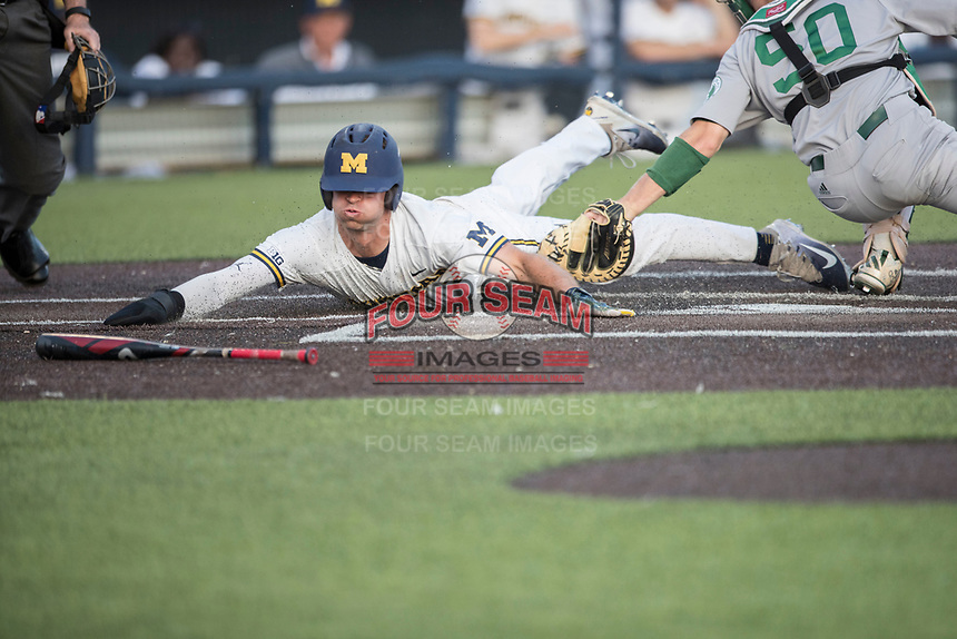 Michigan Wolverines outfielder Jonathan Engelmann (2) slides at home plate as Eastern Michigan Eagles catcher Jeremy Stidham (50) attempts to tag him during the NCAA baseball game on May 16, 2017 at Ray Fisher Stadium in Ann Arbor, Michigan. Michigan defeated Eastern Michigan 12-4. (Andrew Woolley/Four Seam Images)