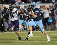 NWA Democrat-Gazette/ANDY SHUPE<br /> Luke Hannon (right) of Har-Ber carries the ball as Kennedy Wade (14) of Fayetteville pursues Saturday, Dec. 5, 2015, during the first half of the Class 7A state championship game at War Memorial Stadium in Little Rock. Visit nwadg.com/photos to see more photographs from the game.