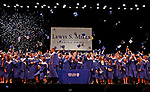 Torrington, CT 062117MK13 Caps and confetti fly during the Lewis Mills High School commencement exercises at the Warner Theatre in Torrington on Wednesday night. Michael Kabelka / Republican-American