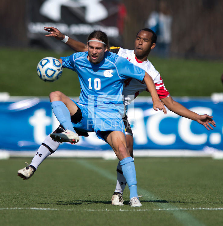 Jordan Cyrus (14) of Maryland stays close to Andy Craven (10) of North Carolina during the game at the Maryland SoccerPlex in Germantown, MD. Maryland defeated North Carolina, 2-1,  to win the ACC men's soccer tournament.