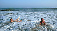 Children play in the ocean on Lucy Vincent Beach in Chilmark..........