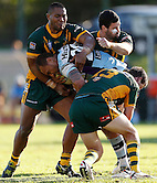 Sam Tagataese of the Cronulla Sharks is wrapped up by some heavy Wyong Roos defence during Round 5 of the 2013 NSW Cup at Morrie Breen Oval on April 7, 2013 in Wyong, Australia. (Photo by Paul Barkley/LookPro)