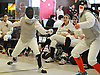 Kate Dirks of Garden City, left, battles Kaitlyn Cheng of Great Neck South in a foil bout during a fencing meet at Garden City High School on Saturday, Jan. 9, 2016. Dirks won the bout 5-2.