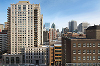 View over the high-rise buildings of the city of Montreal, from the penthouse suite in the Mount Stephen Hotel, opened 1st May 2017, in George Stephen House, built 1880-1883 in Italian Renaissance style as a mansion for George Stephen, 1st Baron Mount Stephen, 1829–1921, formerly the Mount Stephen Club, a gentleman's club, on Drummond St in the Golden Square Mille district, Ville-Marie, Montreal, Quebec, Canada. Picture by Manuel Cohen