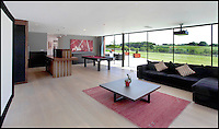 BNPS.co.uk (01202 558833)<br /> Pic: Jackson-Stops&amp;Staff/BNPS<br /> <br /> Cinema/games room with bar...<br /> <br /> For sale - Super home with its own leisure centre attached.<br /> <br /> The buyers of this stunning country property will never need to leave home again - with their own leisure complex at their fingertips.<br /> <br /> Birchwood House in Hoar Cross, Staffs, is a bespoke five-bedroom house that makes the most of the incredible countryside surrounding it with floor to ceiling windows in most rooms.<br /> <br /> But the really unusual selling feature is its unsurpassed leisure suite with a purpose-built gym, 15-metre swimming pool, sauna and steam room. <br /> <br /> It might save you a fortune in gym fees, but any wannabe owners will need &pound;2.75million to get their hands on this cutting edge, contemporary pad.<br /> <br /> The house also has a media room which currently has a pool table and a home cinema, meaning you really could settle in for the long haul.