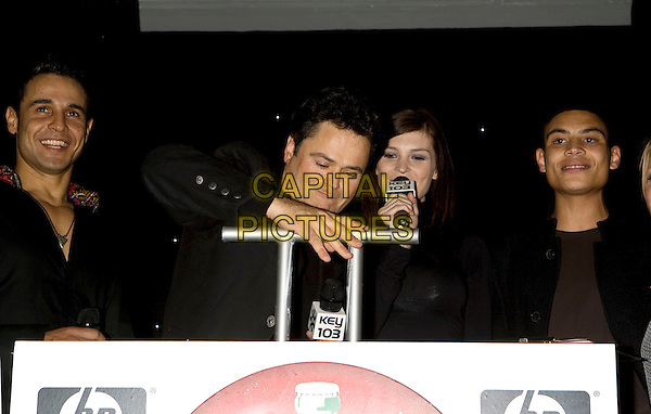 CHICO SLIMANI & DONNY OSMOND.Trafford Centre Christmas Lights switch on, Manchester, England..October 25th, 2007.half length black gesture lever .CAP/AT.©Alan Towse/Capital Pictures.