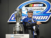 Nov. 21, 2009; Homestead, FL, USA; NASCAR Nationwide Series owner J.D. Gibbs with the championship trophy during the Ford 300 at Homestead Miami Speedway. Mandatory Credit: Mark J. Rebilas-