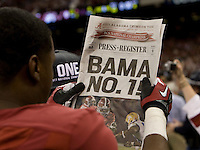 Alabama player holds up newspaper after winning BCS National Championship game against LSU at Mercedes-Benz Superdome in New Orleans, Louisiana on January 9th, 2012.   Alabama defeated LSU, 21-0.