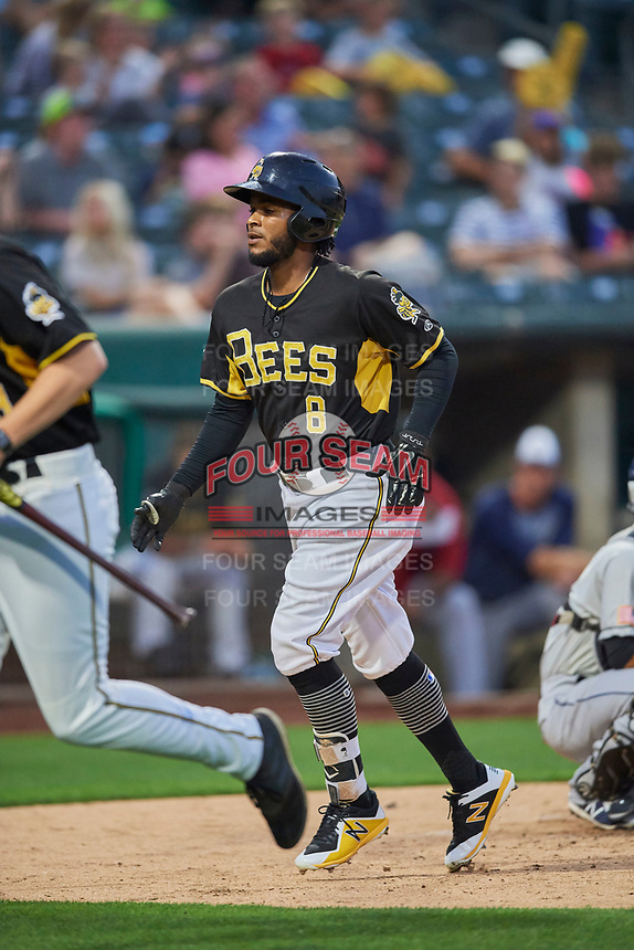Alberto Triunfel (8) of the Salt Lake Bees crosses home plate after hitting a home run against the El Paso Chihuahuas at Smith's Ballpark on August 14, 2018 in Salt Lake City, Utah. El Paso defeated Salt Lake 6-3. (Stephen Smith/Four Seam Images)