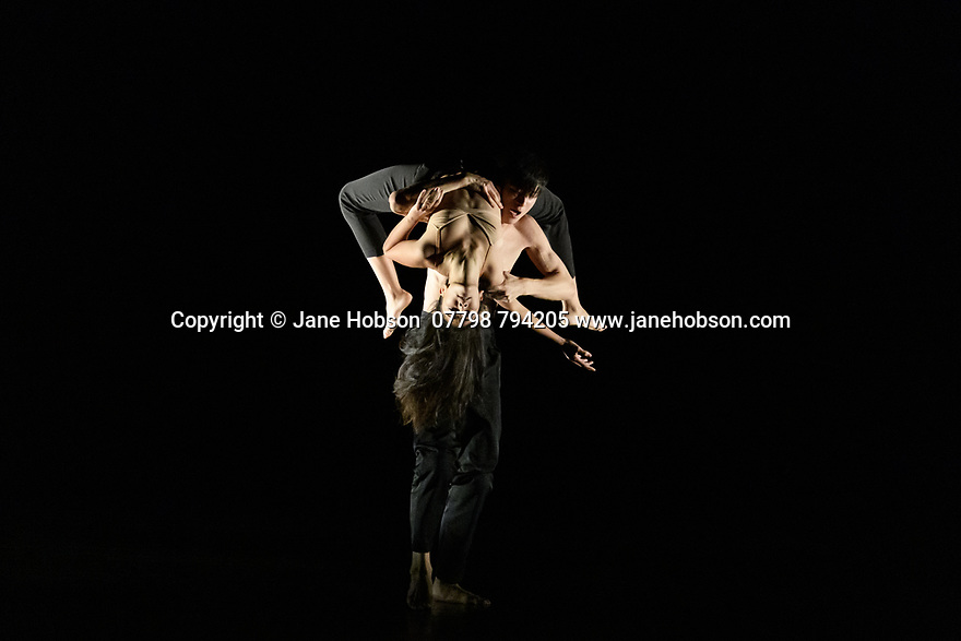 """London, UK. 04.11.2019. Rambert2 presents """"Sin"""", at Sadler's Wells theatre, choreographed by Sidi Larbi Cherkaoui and Damien Jalet, with lighting design by Adam Carree and costume design by Alexandra Gilbert. Picture shows: Melody Tamiz and Chen Peng. Photograph © Jane Hobson."""