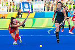 Laura Unsworth #4 of Great Britain passes before Lidewij Welten #12 of Netherlands can cover during Netherlands vs Great Britain in the gold medal final at the Rio 2016 Olympics at the Olympic Hockey Centre in Rio de Janeiro, Brazil.