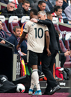 Man Utd manager Ole Gunnar Solskjaer with Marcus Rashford of Man Utd who comes off with a groin injury during the Premier League match between West Ham United and Manchester United at the Olympic Park, London, England on 22 September 2019. Photo by Andy Rowland / PRiME Media Images.