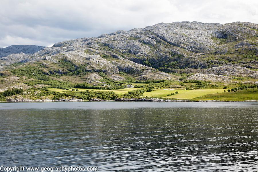 Rocky coastal rural farming landscape near Bronnoy, Bronnoysund, Nordland, Norway