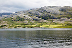 Rocky coastal rural farming landscape near Sandnessjoen, Nordland, Norway