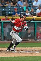 Jordan Patterson (10) of the Albuquerque Isotopes follows through on his swing against the Salt Lake Bees during the Pacific Coast League game at Smith's Ballpark on August 30, 2016 in Salt Lake City, Utah. The Bees defeated the Isotopes 3-2. (Stephen Smith/Four Seam Images)