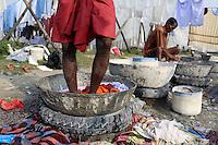 Men washing sheets in Kolkata, India. November, 2013