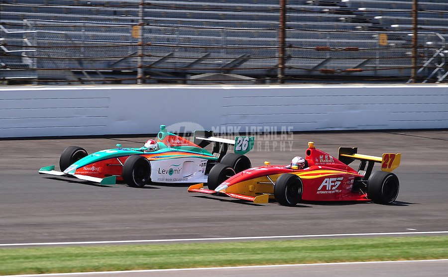 May 28, 2010; Indianapolis, IN, USA; Indy Light Series driver Martin Plowman (27) races alongside Charlie Kimball (26) during the Freedom 100 at the Indianapolis Motor Speedway. Mandatory Credit: Mark J. Rebilas-