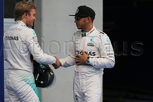 20.06.2015.  Red Bull Ring, Spielberg, Austria. F1 Grand Prix of Austria.   Mercedes AMG Petronas drivers Lewis Hamilton and Nico Rosberg chat and shakes hands after Lewis takes pole and Nico 2nd.