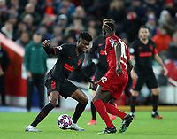 11th March 2020; Anfield, Liverpool, Merseyside, England; UEFA Champions League, Liverpool versus Atletico Madrid;  Thomas Partey of Atletico Madrid takes on Sadio Mane of Liverpool