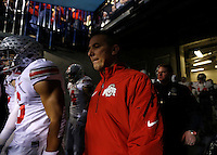 Ohio State Buckeyes head coach Urban Meyer gets ready to lead his team on the field prior to the Big Ten Championship football game at Lucas Oil Stadium in Indianapolis on Friday, December 7, 2013. (Columbus Dispatch photo by Jonathan Quilter)