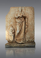 Roman Sebasteion relief  sculpture of Hygieia, Aphrodisias Museum, Aphrodisias, Turkey. <br /> <br /> Hygieia, the goddess of Health, hold a flat bowl (phiale) from which she feeds a snake. The snake is wound twice around her forearm. A plump naked child sits on a square pedestal. Hygieia was the daughter of the healing god Asklepios, with whom she is paired here