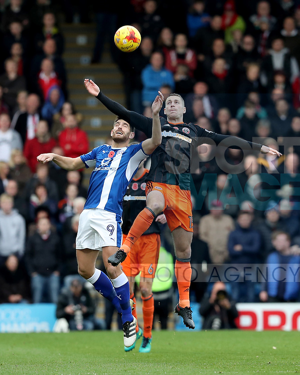 Paul Coutts of Sheffield United tussles in the air with Ched Evans of Chesterfield during the English Football League One match at Proact Stadium, Chesterfield. Picture date: November 13th, 2016. Pic Jamie Tyerman/Sportimage