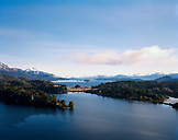 ARGENTINA, Patagonia, scenic view of the Llao Lao Lodge Hotel and the Nahuel Huapi Lake with mountains in the background