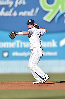 Asheville Tourists shortstop Brendan Rodgers (1) makes a play during a game against the Hagerstown Suns at McCormick Field on June 8, 2016 in Asheville, North Carolina. The Tourists defeated the Suns 10-8. (Tony Farlow/Four Seam Images)
