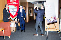 Robert Filipp (right) takes a picture of Philippe Douste-Blazy (center) and professor Rifat Atun (left) during Douste-Blazy's visit to Harvard University's T. H. Chan School of Public Health in Boston, Massachusetts, USA. Filipp is the president of the Innovative Finance Foundation and helped organize Douste-Blazy's visit to Harvard. Atun is the director of the Global Health Systems Cluster and a Professor of Global Health Systems at the School of Public Health. The visit is part of his campaign to become Director General of the World Health Organization. During the visit, he met with professors, students, and visiting scholars, including former Ministers of Health from England and Brazil. Doutse-Blazy is Under-Secretary-General and Special Adviser on Innovative Financing for Development in the United Nations and chairman of UNITAID. He served as Minister of Health, Minister of Culture, and Foreign Minister in the French government and was also mayor of Lourdes and Toulouse.
