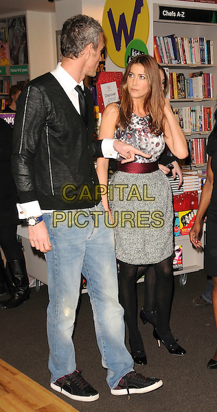 "MARK FOSTER & LISA SNOWDON.At a ""Strictly Come Dancing"" book signing, Waterstones, Oxford Street,  London, England, November 13th 2008..full length red grey gray white print top skirt black tights shoes jeans top sweater  white shirt tie trainers .CAP/CAS.©Bob Cass/Capital Pictures"