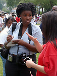 Newsday Photo Intern Laslie Barbour getting caption info among the Freeport School District 4th graders attending the 8th annual Adopt a Cop program's year end Adopt A Cop Day festivity at Freeport Recreation Center in Freeport on Thursday June 17, 2004. (Newsday Photo / Jim Peppler).