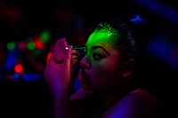 A Salvadoran sex worker applies makeup before beginning a work shift at a night sex club in San Salvador, El Salvador, 8 April 2018. Although prostitution is not legal in El Salvador, dozens of street sex workers, wearing provocative miniskirts, hang out in the dirty streets close to the capital's historic center. Sex workers of all ages are seen on the streets but a significant part of them are single mothers abandoned by their male partners. Due to the absence of state social programs, they often seek solutions to their economic problems in sex work. The environment of street sex business is strongly competitive and dangerous, closely tied to the criminal networks (street gangs) that demand extortion payments. Therefore, sex workers employ any tool at their disposal to struggle hard, either with their fellow workers, with violent clients or with gang members who operate in the harsh world of street prostitution.