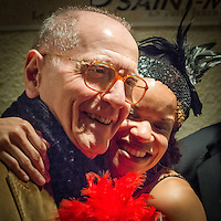 Yves Riquet and Nicolle Rochelle at a jazz concert by the Fantastic Harlem Drivers at the Petit Journal St Michel, Paris, Saturday 19th April 2014. The Fantastic Harlem Drivers consist of pianist Lou Lauprete, clarinetist Alain Marquet, double bass player Bernard Brimeur, and vocalists Sylvia Howard and Nicolle Rochelle, accompanied by tap-dancers Jelly Germain, his son Osiris Germain and Caroline Podetti. Lou Lauprete and Alain Marquet are regulars at Paris Boogie Speakeasy, the  private Parisian jazz club founded and run by Yves Riquet. Sylvia Howard sings with the Duke Ellington orchestra and the Black Label Swingtet, each led by saxophone player Christian Bonnet. Nicolle Rochelle is an internationally known singer, dancer, and actress, the star of Jerome Savary's 'Josephine' which ran for four years in France and Europe, in which Nicolle took the lead role as Josephine Baker. The evening was also attended by Yves Riquet (Sponsor and founder of Paris Boogie Speakeasy) and Jean-Paul Amouroux introduced as the finest player of Boogie-Woogie in Europe. The Fantastic Harlem Drivers were recently recorded for a new CD at Paris Boogie Speakeasy, 256 Rue Marcadet, Paris. Saturday 19th April 2014.
