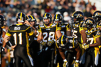 Jul 7, 2007; Hamilton, ON, CAN; Hamilton Tiger-Cats quarterback (11) Jason Maas, running back (28) Jesse Lumsden, fullback (0) Dickerson, wide receiver (77) Jo Jo Walker and teammates huddle during the 2007 season home opener against the Toronto Argonauts at Ivor Wynne Stadium. The Argos defeated the Tiger-Cats 30-5. Mandatory Credit: Ron Scheffler, Special to the Spectator.