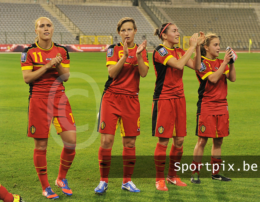 20130921 - BRUSSELS , BELGIUM : Belgian Janice Cayman (11) , Niki De Dock (6) , Audrey Demoustier (8) and Davina Philtjens (2) pictured during the female soccer match between Belgium and Albania , on the first matchday in group 5 of the UEFA qualifying round to the FIFA Women World Cup in Canada 2015 at the Koning Boudewijn Stadion , Brussels . Saturday 21th September 2013. PHOTO DAVID CATRY