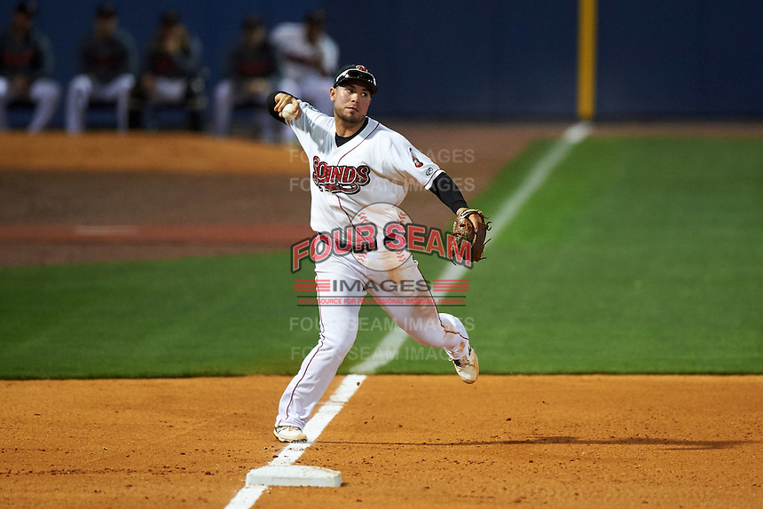 Nashville Sounds third baseman Renato Nunez (34) throws to first during a game against the Iowa Cubs on May 3, 2016 at First Tennessee Park in Nashville, Tennessee.  Iowa defeated Nashville 2-1.  (Mike Janes/Four Seam Images)