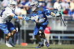 08 February 2015: Air Force's Christopher Allen (right) is defended by Duke's Pat Resch (left). The Duke University Blue Devils hosted the United States Air Force Academy Falcons at Koskinen Stadium in Durham, North Carolina in a 2015 NCAA Division I Men's Lacrosse match. Duke won the game 13-7.