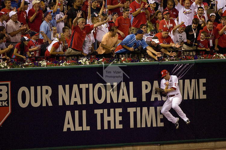 071409tvjaysonwerth.Phillies outfielder Jayson Werth slams into the outfield wall as he makes a catch late in the game..BND/TIM VIZER