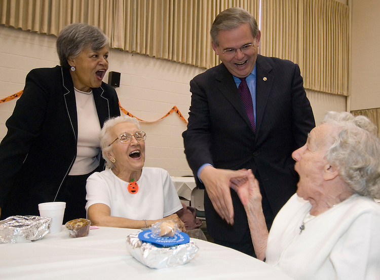 New Jersey Assemblywoman and Majority Leady Bonnie Watson Coleman, left, and Sen. Robert Menendez, D-N.J., shake hands with seniors at the Ewing Community Center in Ewing, N.J., on Friday, Oct. 27, 2006. Sen. Menendez spoke to the crowd of mostly senior citizens during their annual Harvest Dance at the community center.