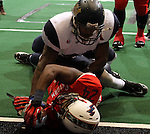 SIOUX FALLS, SD - MARCH 17:  Johnathan Dandridge #24 from the Sioux Falls Storm scores as he was brought down by Dextrell Simmons #20 from the Wyoming Calvary in the first quarter of their game Sunday afternoon at the Sioux Falls Arena. (Photo by Dave Eggen/Inertia)