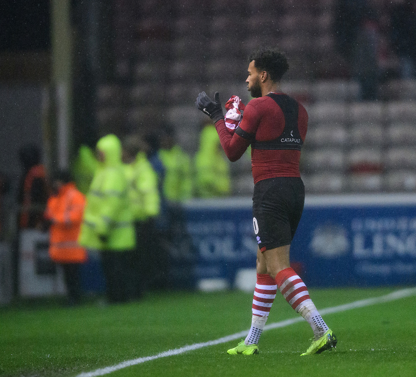 Lincoln City's Matt Green throws his shirt to a fan in the Lincolnshire Co-operative Stand at the end of the game<br /> <br /> Photographer Chris Vaughan/CameraSport<br /> <br /> The EFL Sky Bet League Two - Saturday 15th December 2018 - Lincoln City v Morecambe - Sincil Bank - Lincoln<br /> <br /> World Copyright © 2018 CameraSport. All rights reserved. 43 Linden Ave. Countesthorpe. Leicester. England. LE8 5PG - Tel: +44 (0) 116 277 4147 - admin@camerasport.com - www.camerasport.com